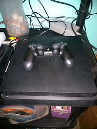 black Sony PS4 console with controller Olney, 20832