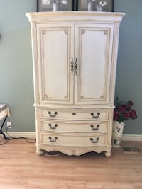 Thomasville Country French bedroom set with king size headboard, footboard and side rails.  An armoire with 2 large doors and 3 drawers.  A chest of drawers with 6 large drawers and 2 smaller ones.  Also a dresser with dark wood top and matching mirror. Thousand Oaks, 91360