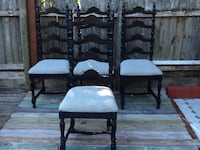Two black wooden framed white padded chairs Rotonda West, 33947