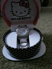 round silver-colored analog watch with link bracelet 401 mi