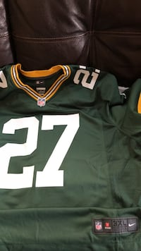 green, white, and yellow number 27 NFL jersey shirt Madison, 53715