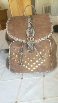 New Really cute Brown studded back pack