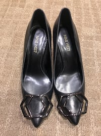 pair of black leather flats Vancouver, V6J 1R1
