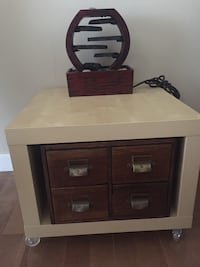 Antique 4 drawer catalogue cabinet and roller end table and fountain. All 3 prices for $100. Calgary, T3G 1Z9