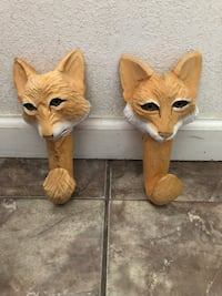 Two brown-and-white cat figurines