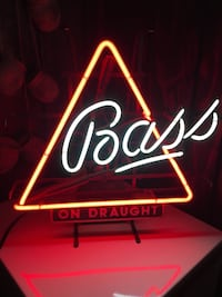 Bass Neon Beer sign underneath on draft sign