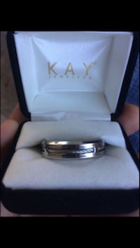 silver-colored Kay ring with box