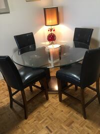 Dining round table glass/4 Black leather chairs. Mississauga, L5R 3E5