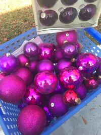 Glitzy christmas decor. (whole box of balls, different sizes) a matching mini purple tree with lights(no stand), a pink dog stocking, and a red and sequin tree skirt Marietta, 30066