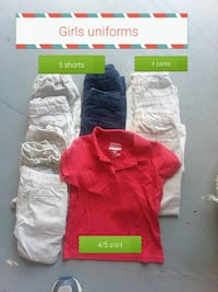 white and black pant lot and red polo shirt