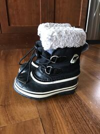 Black-and-white sorel snow boots