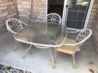 Glass top patio table and 3 chairs with cushions  Des Moines, 50312