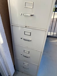 Tall metal file cabinet