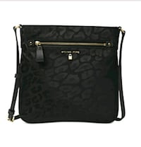 black monogrammed Coach leather crossbody bag