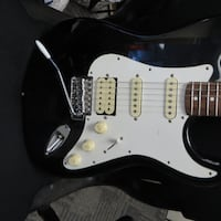 ELECTRIC GUITAR SAMICK 4 PICKUPS BLACK AND WHITE Calgary