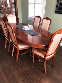 oval brown wooden table with four chairs dining set Caledon, L7C 2G2