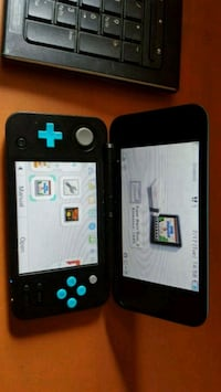 2ds xl with charger and 2 ganes Lafayette, 70501