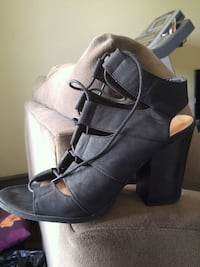 pair of black leather chunky heeled booties Edmonton, T5P 4N6