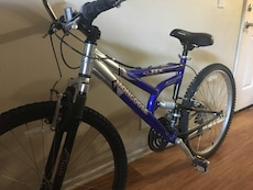 Silver And Blue Mongoose Mountain Bike