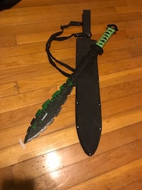 green and black handle sword with sheath
