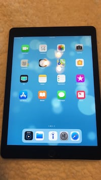 black iPad with blue case Humble, 77338