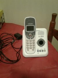 white and gray VTech wireless home telephone
