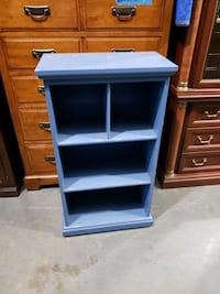 Small light blue bookcase