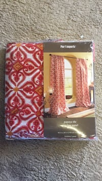 red and white window curtain with pack