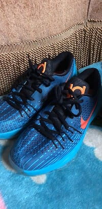 pair of blue-and-black Nike running shoes Arlington