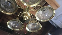 white downlight chandelier with brass-colored frame