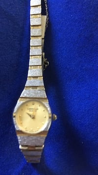 round silver bezel analog watch with silver and gold link strap Toledo, 43614