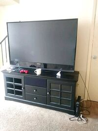black flat screen TV with black wooden TV stand Indianapolis, 46235
