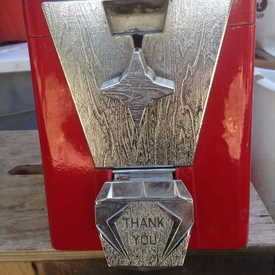 Silver and red gumball dispenser