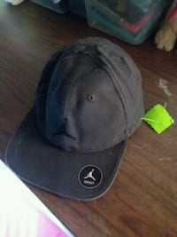 black and gray fitted cap 2290 mi