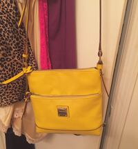 Yellow leather dooney & bourke side satchel with wallet  Melbourne, 32940