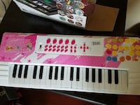 silver and pink electric keyboard