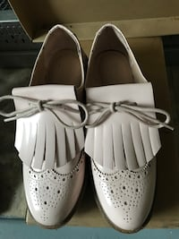 pair of white leather loafers St. Louis, 63113
