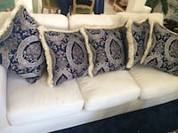5 blue and gold pillows