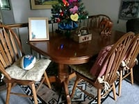 rectangular brown wooden dining table with four padded windsor chairs 45 km