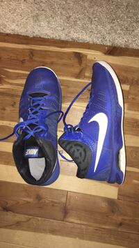 Pair of blue nike basketball shoes size 11