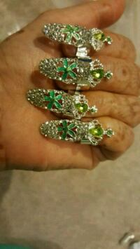 two silver-colored and green gemstone rings Surrey, V3X 1P3