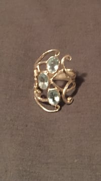 gold-colored clear gemstone encrusted ring