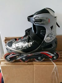 unpaired gray and black inline skate Repentigny, J6A 8C6