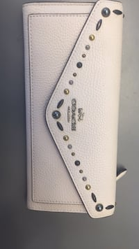 Coach soft wallet with prairie rivets