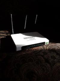 white and black TP-Link modem router