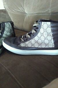 pair of GUCCI high top sneakers