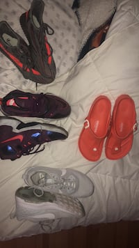 two pairs of red and black Nike basketball shoes Plattsburgh, 12901