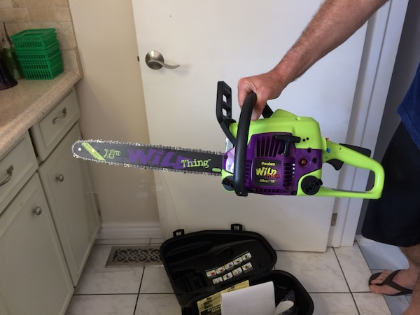 green and purple Poulan wild chainsaw