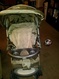 baby's tan stroller Independence