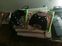 black Xbox 360 console with controller and game ca Terrytown, 70056